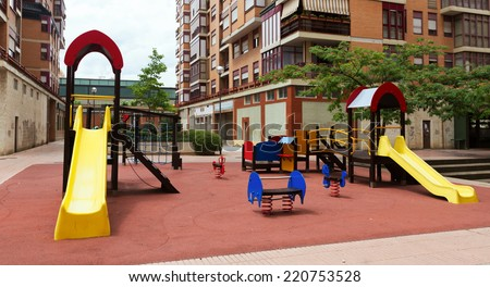 Childrens playground area in cityspace - stock photo