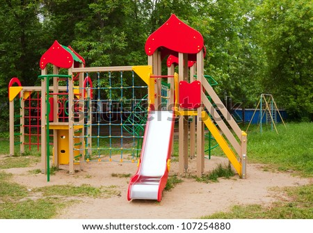Childrens playground area in summer, nobody - stock photo