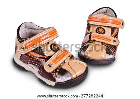 Childrens sandals out of leather on an isolated background