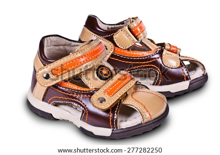 Childrens sandals out of leather on an isolated background - stock photo