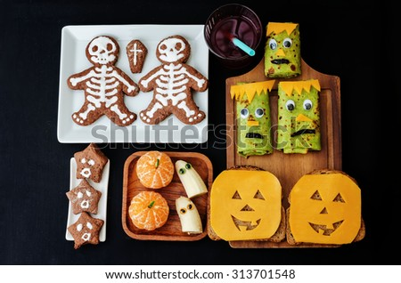childrens with lunch in the form of monsters for Halloween. the toning. selective focus - stock photo