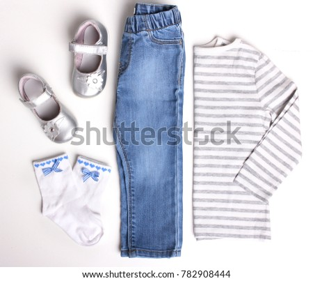 Childs clothes set  isolated on white.