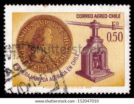 Chile - CIRCA 1968: A stamp printed in Chile shows first coin with a portrait of Ferdinand six and coin press, circa 1968 - stock photo