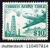 CHILE - CIRCA 1967: a stamp printed in the Chile shows Oil Derricks and Douglas DC-6, circa 1967 - stock photo