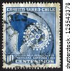 CHILE- CIRCA 1960: Postage stamp printed in Chile shows Map and Rotary Emblem (South American Rotary Regional Conference, Santiago). Scott Catalog C221 AP55, circa 1960 - stock photo