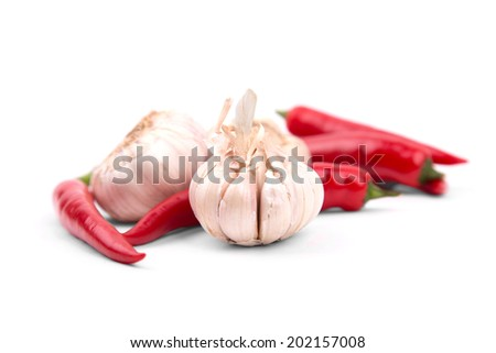 Chile peppers and garlic on a white background with a drop shadow - stock photo
