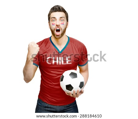 Chilean fan holding a soccer ball celebrates on white background - stock photo