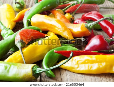 Chili Colorful Peppers, Spicy Raw Peppers on Wooden Background - stock photo