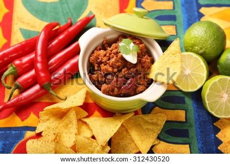 Chili con carne and nachos - stock photo