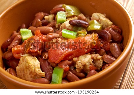 Chili con carne - in American English as simply �¢??chili�¢?�, is a spicy stew containing chili peppers, meat (usually beef), tomatoes and often beans - stock photo