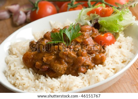 Chili con carne with rice - stock photo