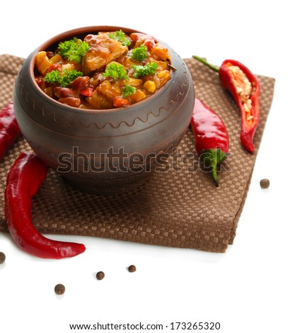 Chili Corn Carne - traditional mexican food, in pot, on napkin, isolated on white - stock photo