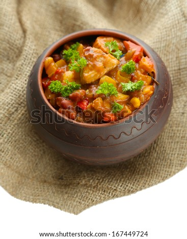 Chili Corn Carne - traditional mexican food, in pot, on sackcloth, isolated on white - stock photo