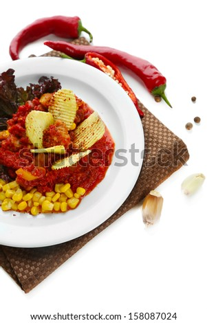 Chili Corn Carne - traditional mexican food, on white plate, on napkin, isolated on white - stock photo