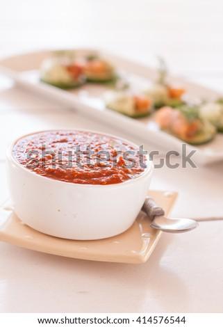 Chili dipping sauce with snacks in the background - stock photo
