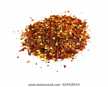 Chili flakes heap isolated on white - stock photo