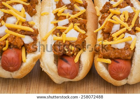 Chili Hot Dogs with Cheese and Onions - stock photo