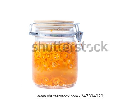 Chili in Vinegar as a hot and sour sauces on White background - stock photo
