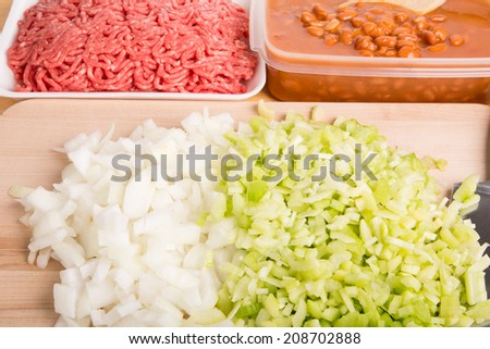 Chili Ingredients of chopped onions, celery with ground beef and kidney beans - stock photo