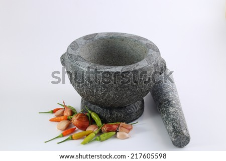 Chili pepper, garlic and shallots with stone mortar, Thai food cooking - stock photo