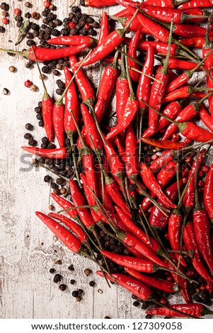 chili peppers and black pepper - stock photo