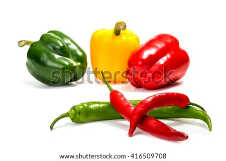 chili peppers and red, yellow and green bell pepper - stock photo