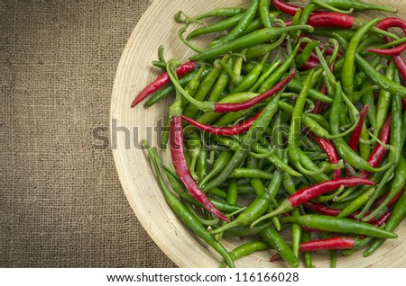 Chili Peppers / Chili peppers in a bowl on sack texture - stock photo