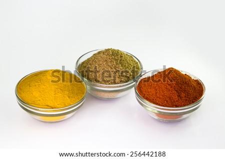 Chili Powder, Turmeric Powder & Coriander powder in Bowl. - stock photo