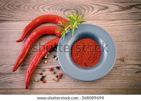 Chili. Red chili pepper. Fresh chili. Chili on wooden background. Chili still life.  - stock photo