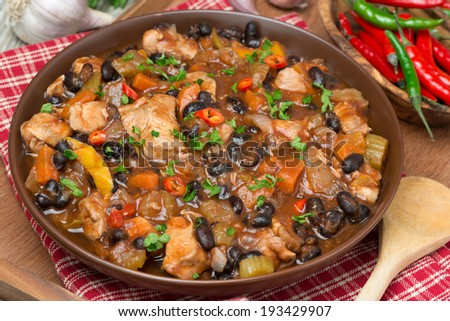 chili with black beans and chicken, top view, close-up