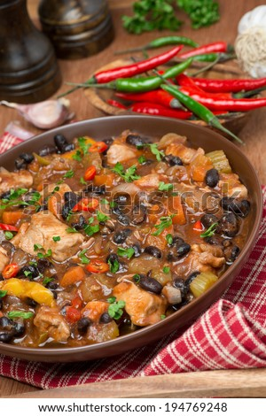 chili with black beans, chicken and vegetables, close-up
