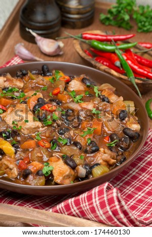 chili with black beans, chicken and vegetables, vertical, close-up