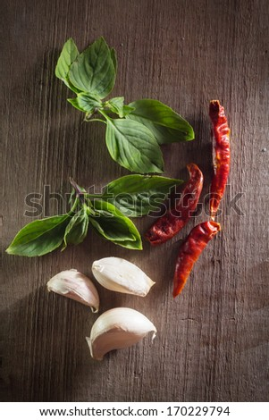 Chili with garlic and basil leaf.  - stock photo