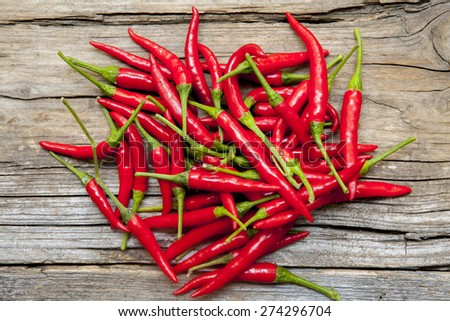 Chilies bunch scattered on wood  - stock photo