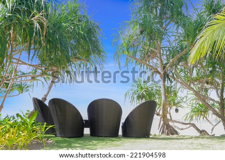 chill out on tropical beach, outdoor cafe, chairs on beach - stock photo