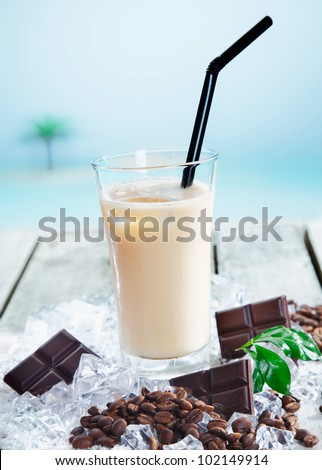 Chilled cafe mocha on ice enjoyed through a straw for a refreshing drink - stock photo