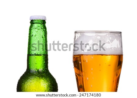 Chilled green bottle with condensate and a glass of beer lager on Isolated white background - stock photo