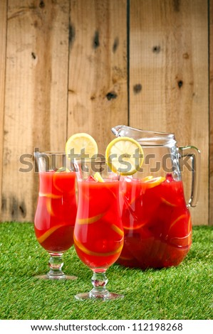Chilled Orange Lemon Sangria with lemon decoration - stock photo