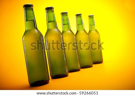 Chilled perfect beer on yellow background!