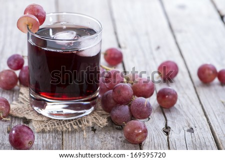 Chilled Red Grape Juice with fresh fruits - stock photo
