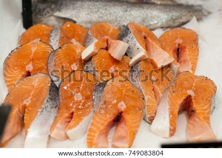 chilled steak of red sturgeon fish in ice frozen red fish steaks in a market