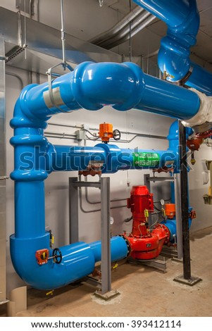 Chilled Water Pump and Insulated Piping used for a building HVAC refrigeration system.