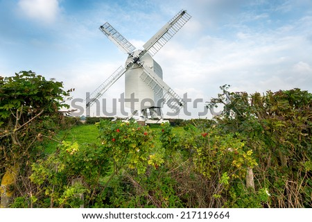 Chillenden Windmill in the Kent countryside, an open trestle post mill - stock photo