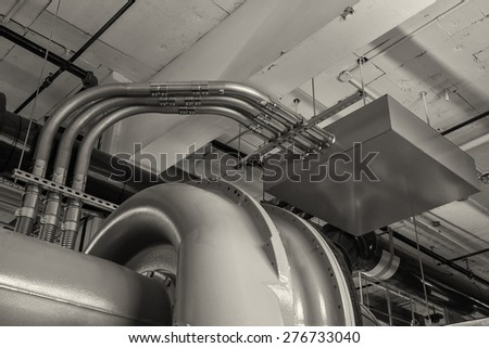 Chiller compressor body and electro mechanical tubing condiuts for service. - stock photo