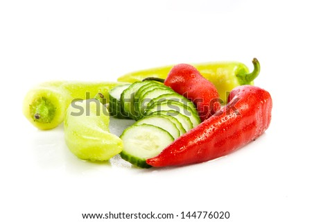 chilli and cucumber isolated on white background