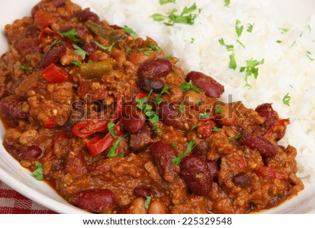 Chilli con carne served with rice - stock photo