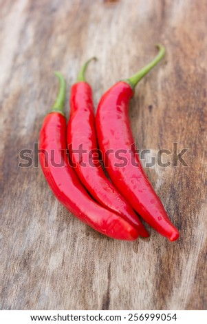Chilli peppers and wood texture , background. - stock photo
