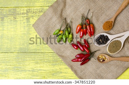 chilli various kinds pepper, spices in wooden spoon on old wooden table. HOT peppers chilli. selective focus image, space for text