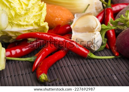 Chillies,garlic,tomato,cabbage,radish on bamboo mat