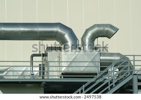 Chimney and pipes of ventilation in plant - stock photo